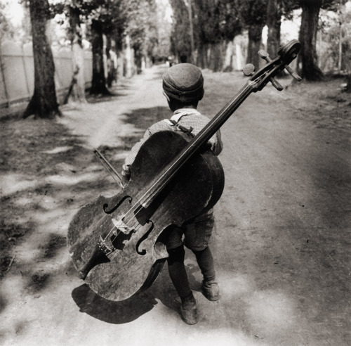 Gypsy boy with cello, Hungary 1931